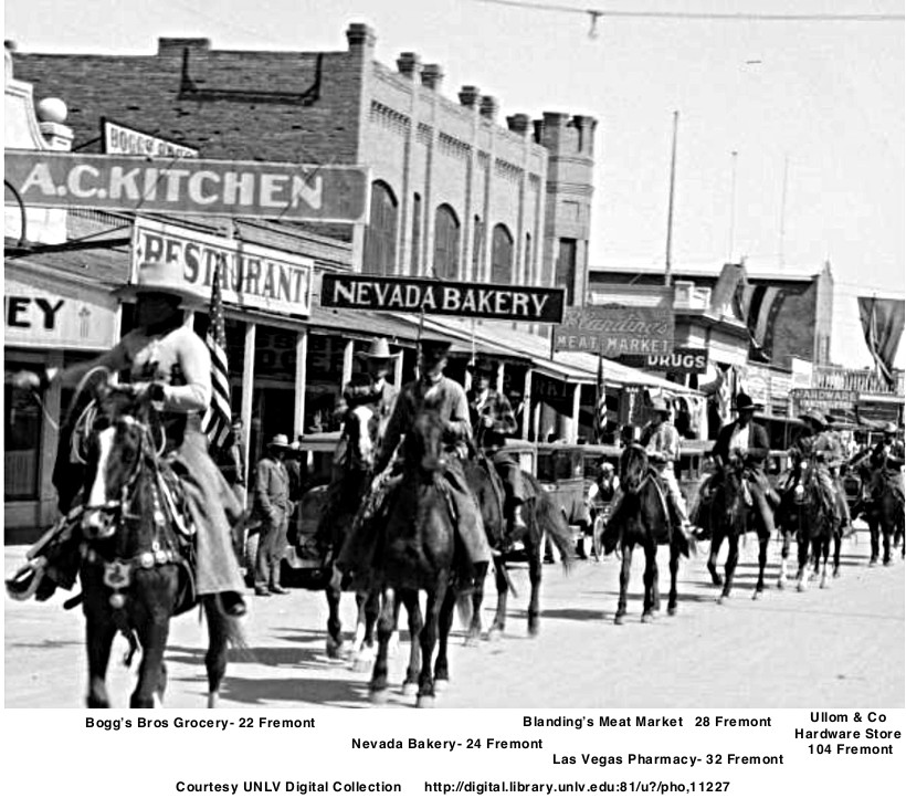 1930's Labor Day parade showing Chop Suey restaurant  A. C. Kitchen  Bogg's Bros Grocery   Nevada Bakery    Blanding's Meat Market  Las Vegas Pharmacy   Ullom & Co Hardware Store