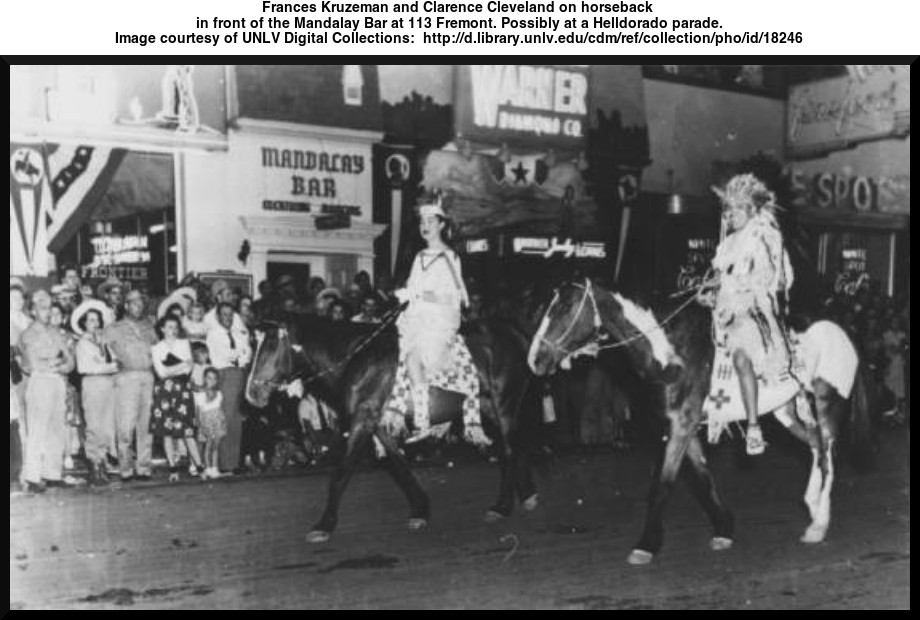 Frances Kruzeman and Clarence Cleveland on horseback in front of the Mandalay Bar at 113 Fremont. Possibly at a Helldorado parade.