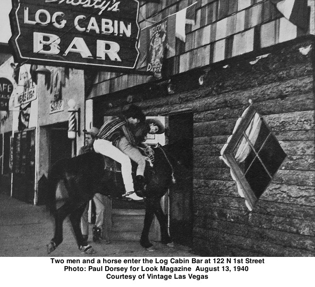 Two men and a horse enter the Log Cabin Bar at 122 N 1st Street