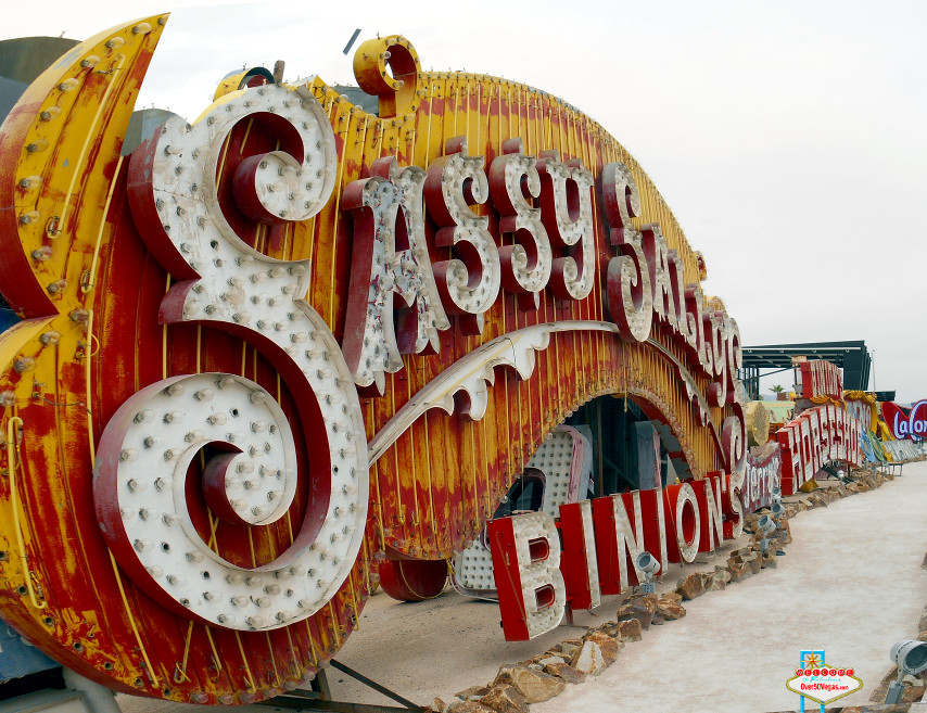 The old Sassy Sally's sign rests along the Binion's Horseshoe sign at the Neon Museum.